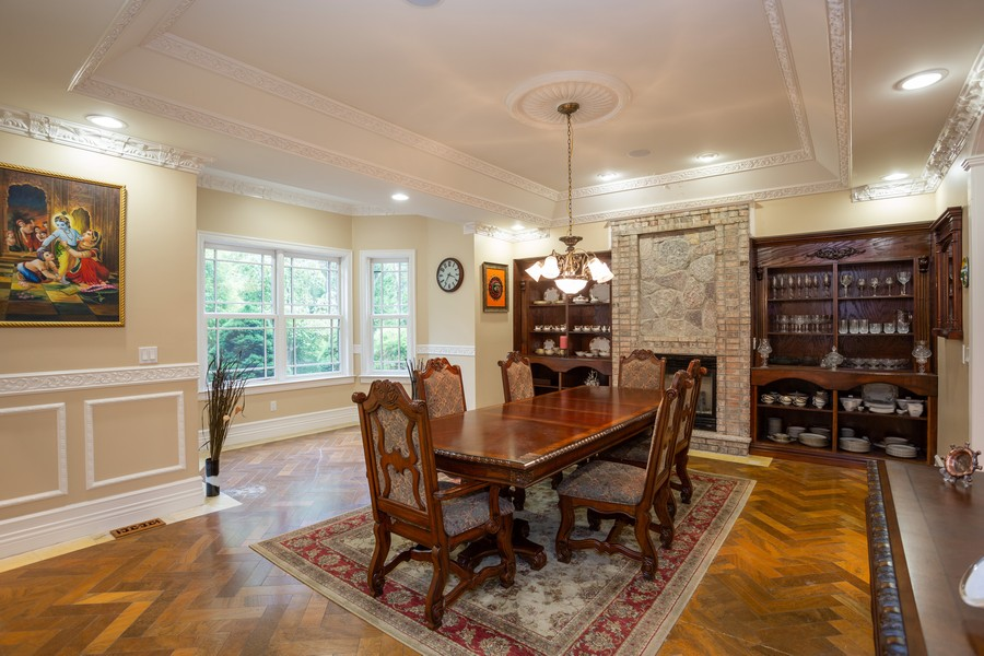 Real Estate Photography - 8 Old Schoolhouse Rd, Manorville, NY, 11949 - Formal Dining Room with Fireplace