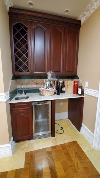 Real Estate Photography - 8 Old Schoolhouse Rd, Manorville, NY, 11949 - Wet Bar with Wine Cooler