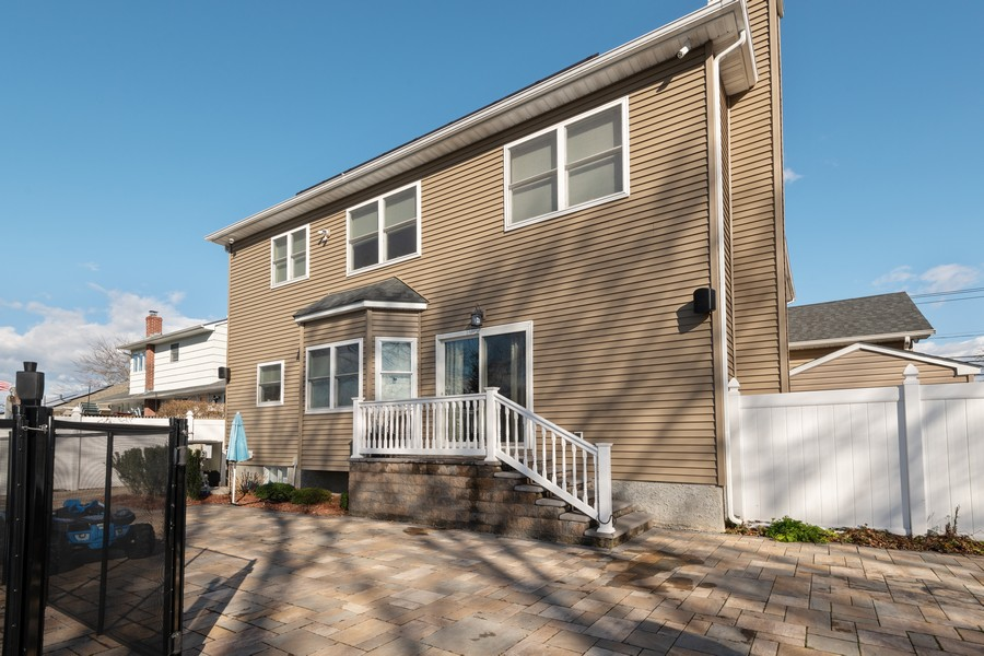 Real Estate Photography - 316 Bellmore Rd, East Meadow, NY, 11554 - Rear View