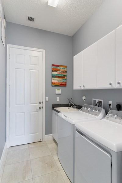 Real Estate Photography - 8880 Golden Mountain Circle, Boynton Beach, FL, 33473 - Laundry Room