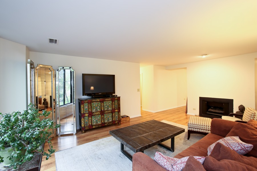 Real Estate Photography - 1401 Burr Oak Rd, Unit 202C, Hinsdale, IL, 60521 - View of Living Room with Fireplace