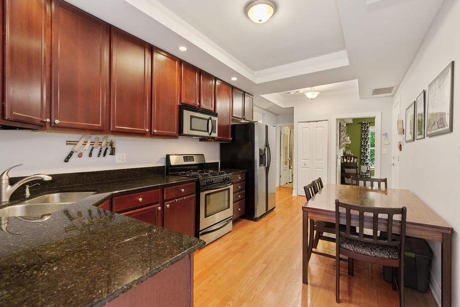 Real Estate Photography - 7035 N Greenview Ave, Unit 1S, Chicago, IL, 60626 - Kitchen