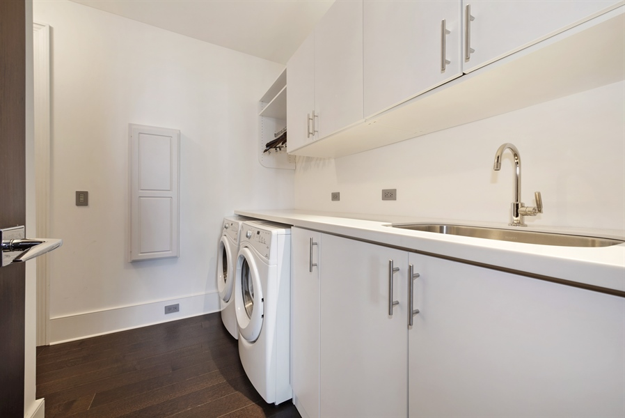 Real Estate Photography - 118 E Erie, unit 38 L, Chicago, IL, 60611 - Laundry Room