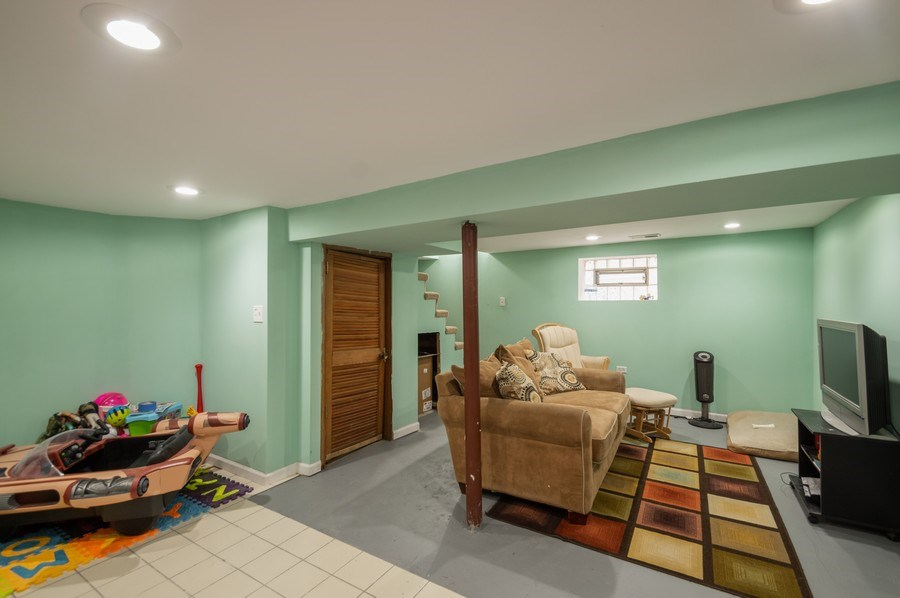Real Estate Photography - 3511 N Normandy, Chicago, IL, 60634 - Family Room (Basement)
