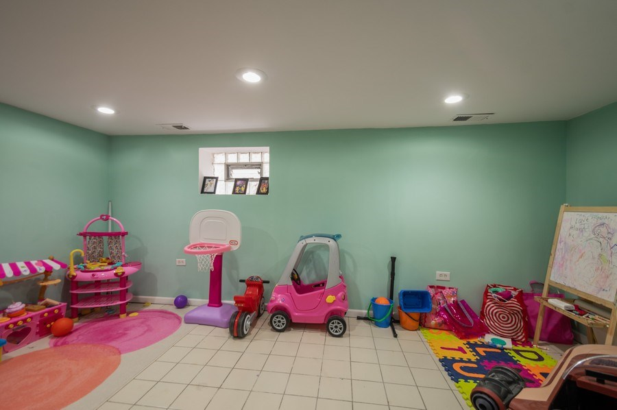 Real Estate Photography - 3511 N Normandy, Chicago, IL, 60634 - Recreation Room (Basement)