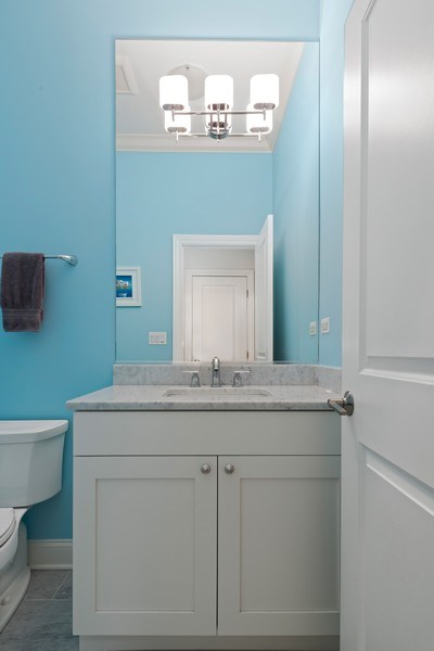 Real Estate Photography - 3841 Janssen Ave, Unit 1, Chicago, IL, 60613 - Powder Room