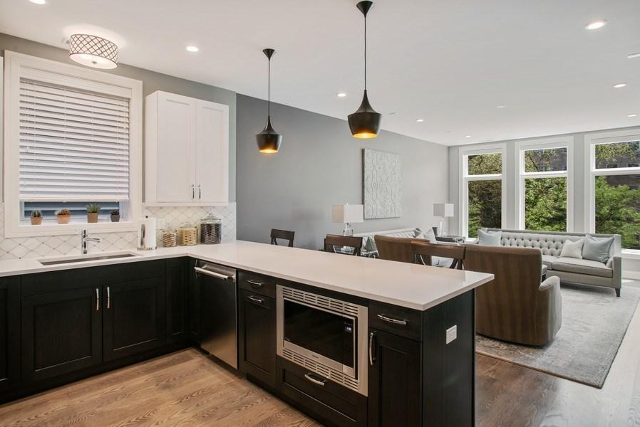 Real Estate Photography - 858 W Aldine, #2, Chicago, IL, 60657 - Kitchen / Living Room