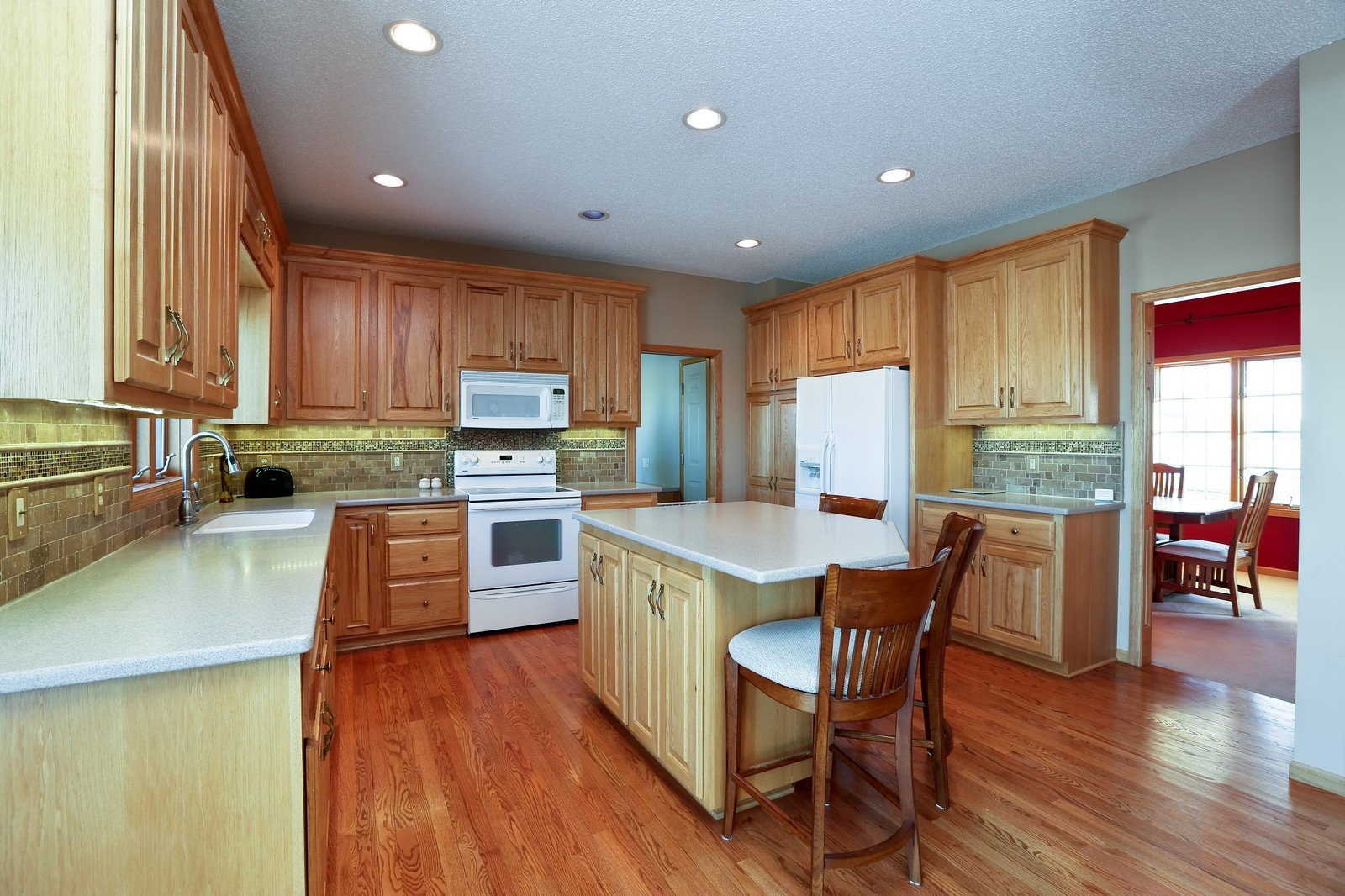 Real Estate Photography - 23160 Meadowview Dr, Corcoran, MN, 55374 - Kitchen