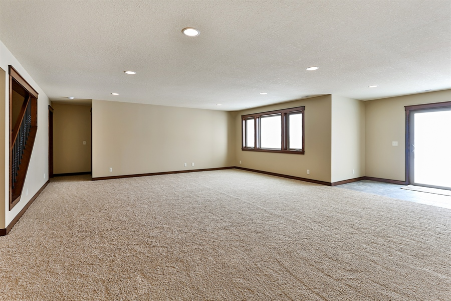 Real Estate Photography - 582 Schwalen DR, Hudson, WI, 54016 - Lower Level walkout family room