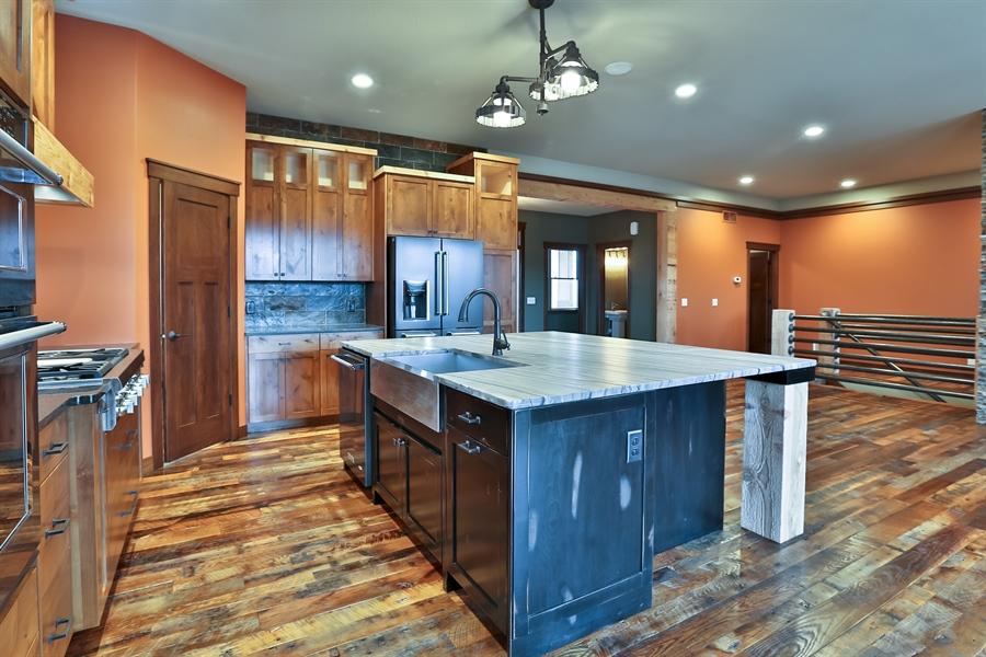 Real Estate Photography - 593 Schwalen Dr, Hudson, WI, 54016 - Kitchen / Dining Room
