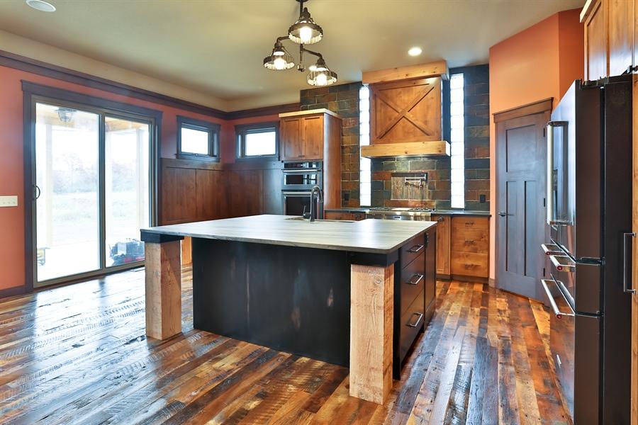 Real Estate Photography - 593 Schwalen Dr, Hudson, WI, 54016 - Living Room / Dining Room