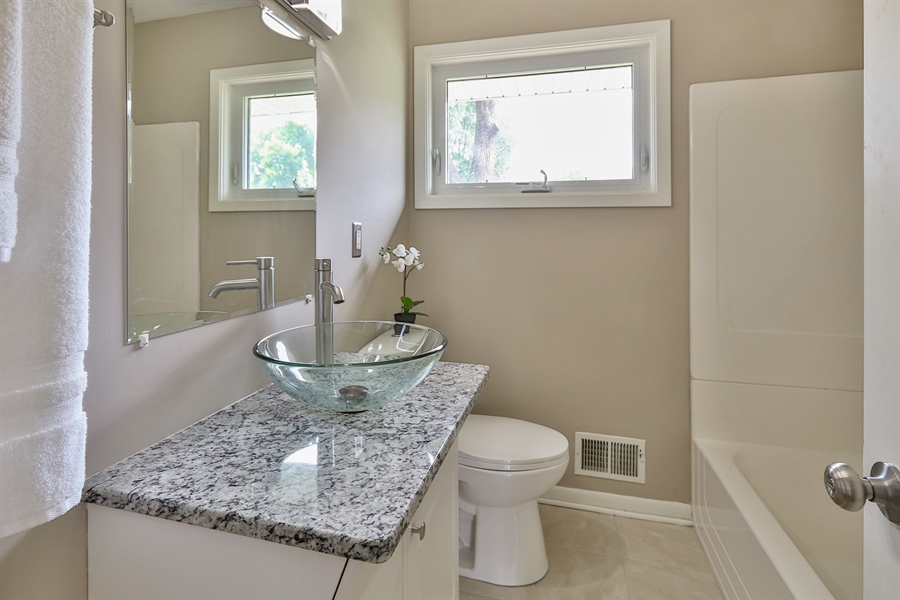 Real Estate Photography - 6225 France Ave N, Brooklyn Center, MN, 55429 - Bathroom