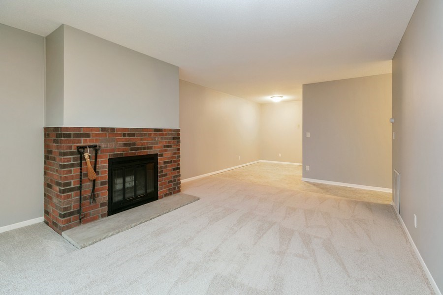 Real Estate Photography - 4575 W 80th Street Cir, Apt. 216, Bloomington, MN, 55437 - Living Room