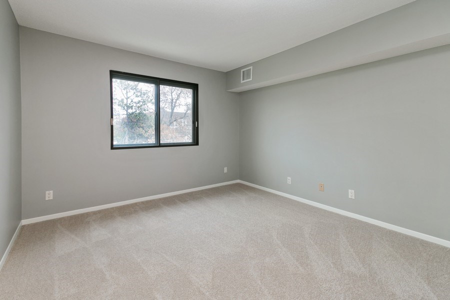 Real Estate Photography - 4575 W 80th Street Cir, Apt. 216, Bloomington, MN, 55437 - Bedroom