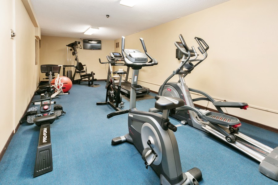 Real Estate Photography - 4575 W 80th Street Cir, Apt. 216, Bloomington, MN, 55437 - Exercise Room