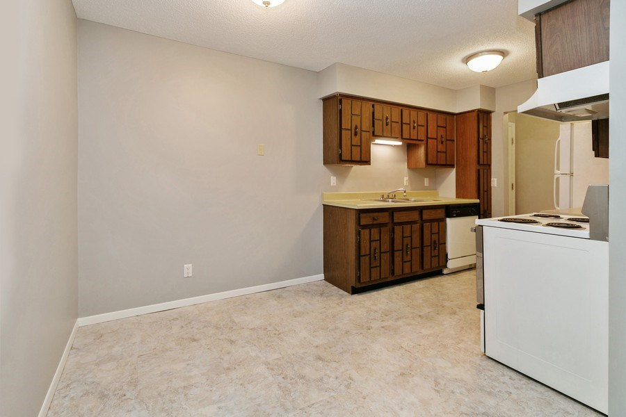 Real Estate Photography - 4575 W 80th Street Cir, Apt. 216, Bloomington, MN, 55437 - Dining Room