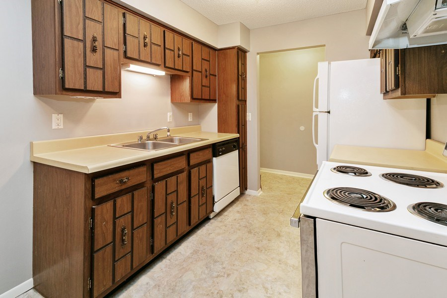 Real Estate Photography - 4575 W 80th Street Cir, Apt. 216, Bloomington, MN, 55437 - Kitchen