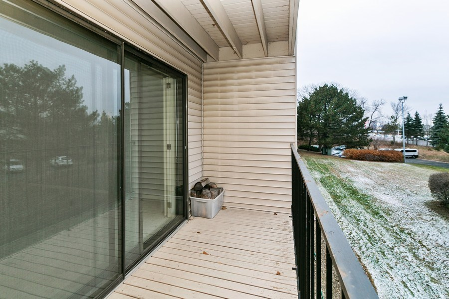 Real Estate Photography - 4575 W 80th Street Cir, Apt. 216, Bloomington, MN, 55437 - Deck
