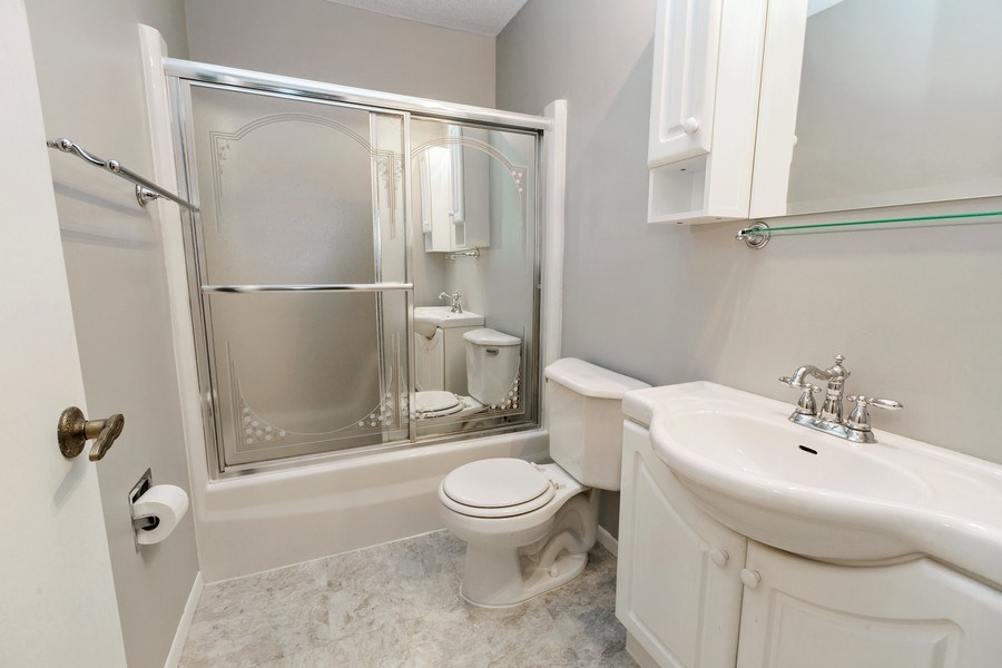 Real Estate Photography - 4575 W 80th Street Cir, Apt. 216, Bloomington, MN, 55437 - Bathroom