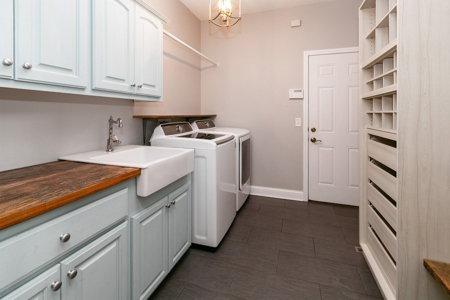 Real Estate Photography - 9817 211th Street, Lakeville, MN, 55044 - Laundry Room