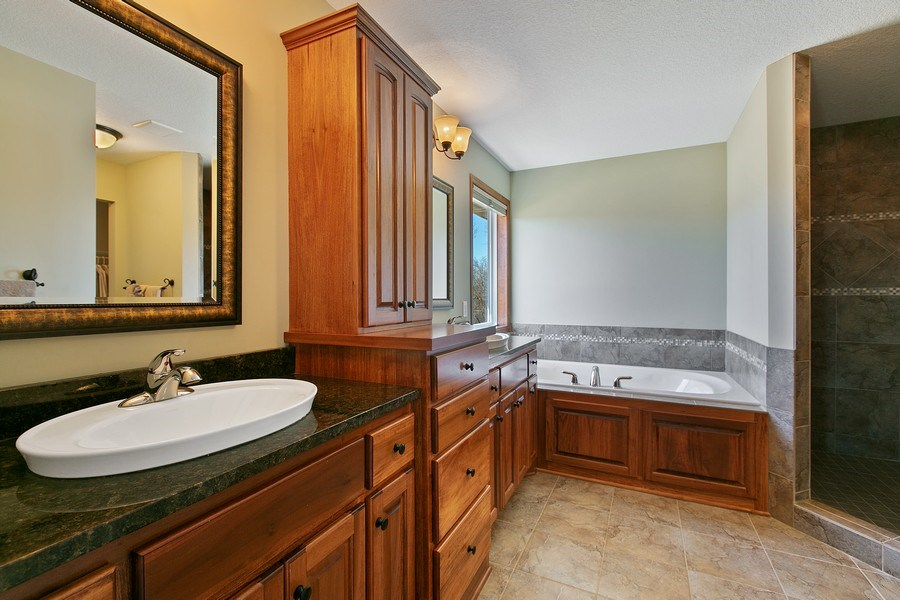 Real Estate Photography - 15385 55th Ct N, Plymouth, MN, 55446 - Master Bath features dual sink, soak tub, walk-in