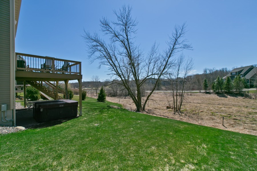 Real Estate Photography - 15385 55th Ct N, Plymouth, MN, 55446 - Enjoy the hot tub on lower level patio