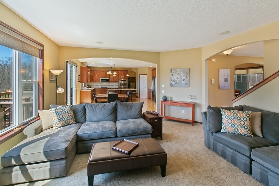 Real Estate Photography - 15385 55th Ct N, Plymouth, MN, 55446 - ...another view of Living Rm/Great Rm to Kitchen