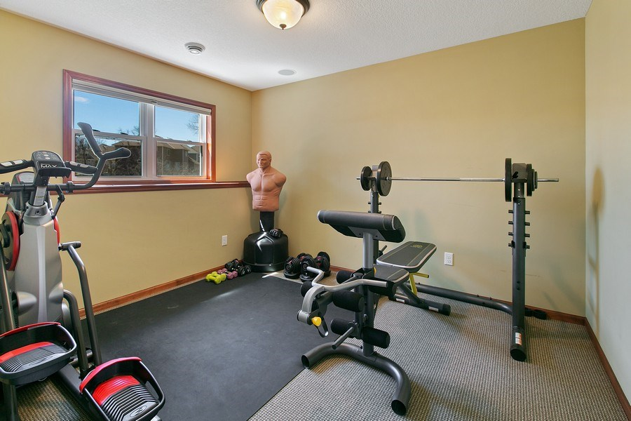 Real Estate Photography - 15385 55th Ct N, Plymouth, MN, 55446 - Exercise Room / Bedroom #5 lower level