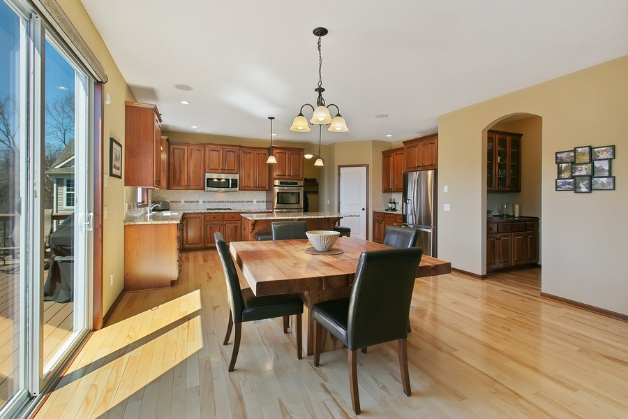 Real Estate Photography - 15385 55th Ct N, Plymouth, MN, 55446 - Overall view of Kitchen, Informal Dining & Butler.