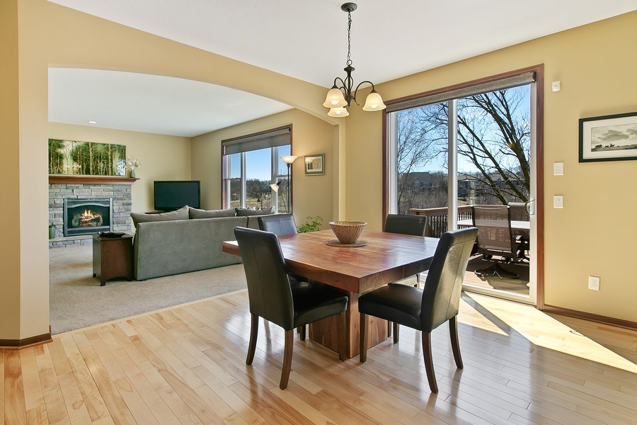 Real Estate Photography - 15385 55th Ct N, Plymouth, MN, 55446 - Informal Dining...Main floor Living Rm, Deck