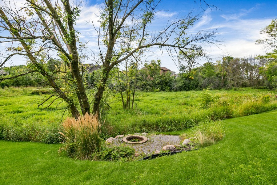 Real Estate Photography - 15385 55th Ct N, Plymouth, MN, 55446 - Fire pit nestled into pretty & private setting