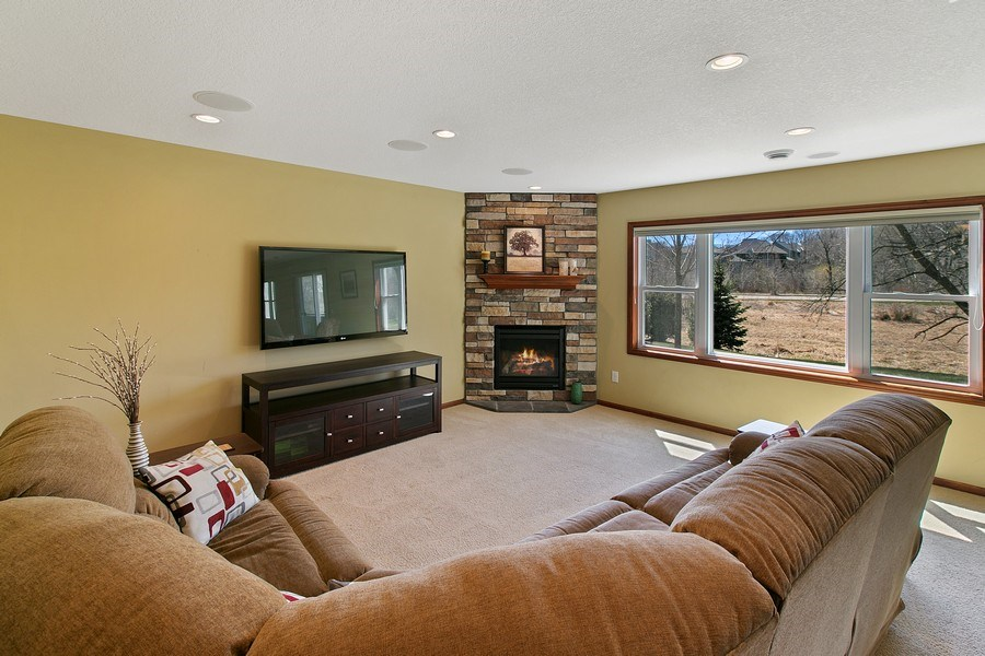Real Estate Photography - 15385 55th Ct N, Plymouth, MN, 55446 - Lower level Amusement Rm w/stone gas fireplace