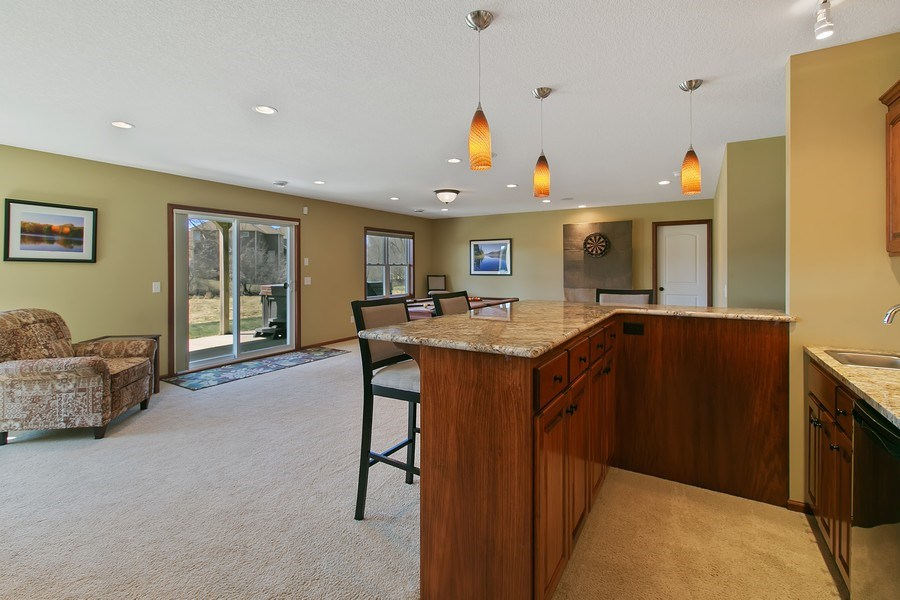 Real Estate Photography - 15385 55th Ct N, Plymouth, MN, 55446 - Lower level walk out Bar/Entertainment Room