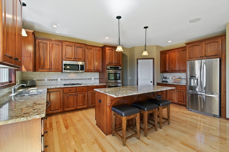 Real Estate Photography - 15385 55th Ct N, Plymouth, MN, 55446 - Sensational Kitchen w/walk-in pantry, granite!