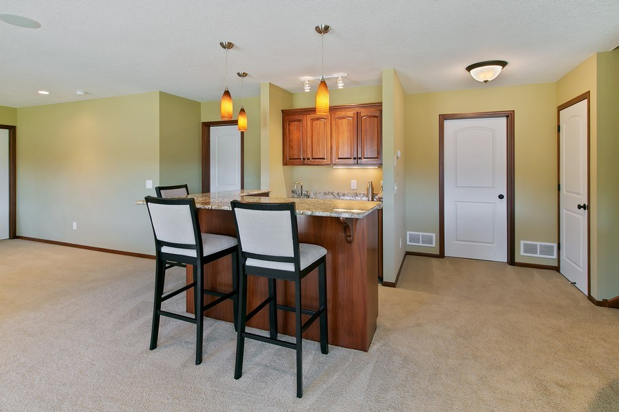 Real Estate Photography - 15385 55th Ct N, Plymouth, MN, 55446 - ...wrap around Bar w/granite, sink, refrigerator