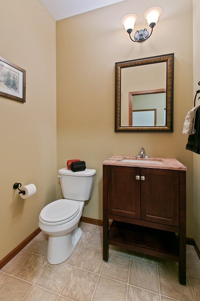 Real Estate Photography - 15385 55th Ct N, Plymouth, MN, 55446 - Main Floor 1/2 Bath within steps off back hall