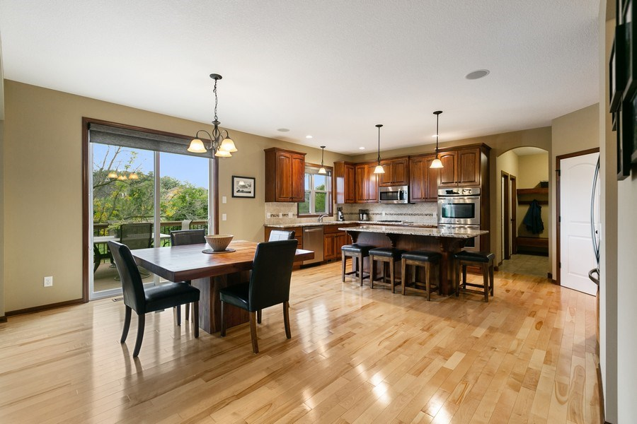 Real Estate Photography - 15385 55th Ct N, Plymouth, MN, 55446 - ++ Lg Informal Dining adjacent to lg Deck