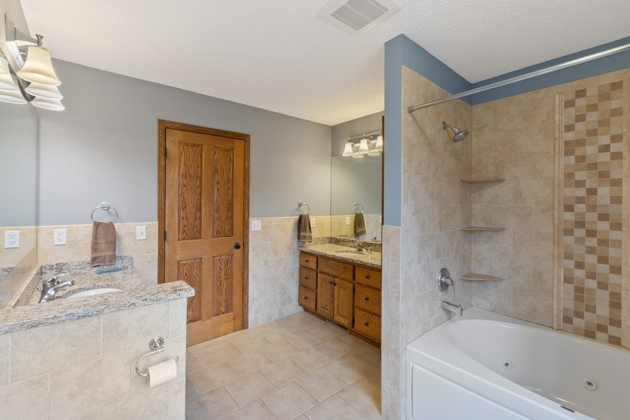 Real Estate Photography - 9480 NE Bataan St, Blaine, MN, 55449 - Master Bathroom