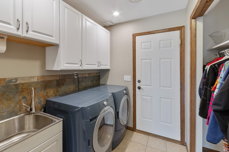 Real Estate Photography - 9480 NE Bataan St, Blaine, MN, 55449 - Laundry Room