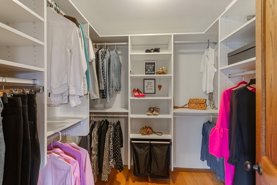 Real Estate Photography - 9480 NE Bataan St, Blaine, MN, 55449 - Master Bedroom Closet