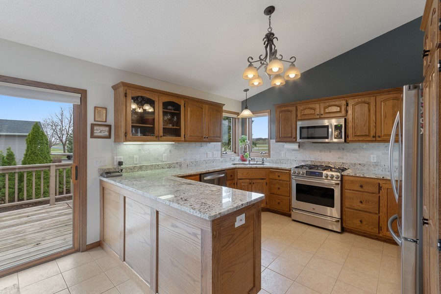 Real Estate Photography - 9480 NE Bataan St, Blaine, MN, 55449 - Kitchen