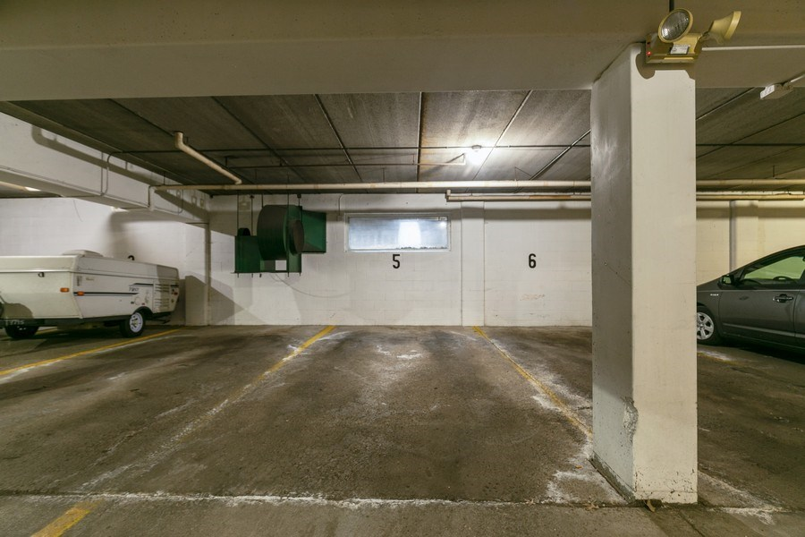 Real Estate Photography - 4045 Hodgson Rd, Unit 109, Shoreview, MN, 55126 - Parking Garage