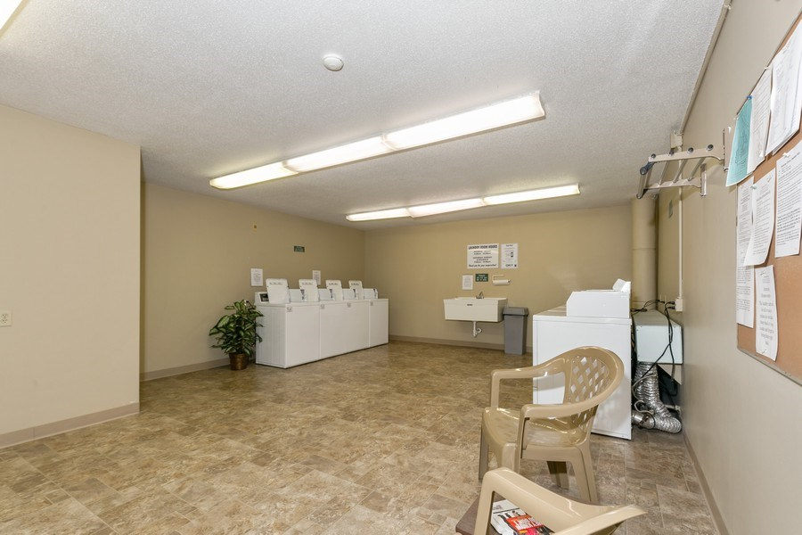 Real Estate Photography - 4045 Hodgson Rd, Unit 109, Shoreview, MN, 55126 - Laundry Room