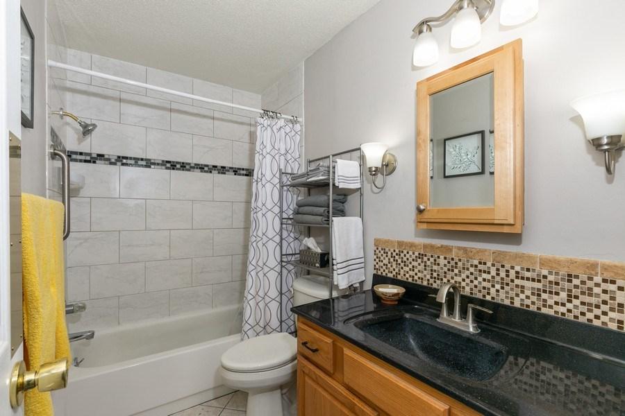 Real Estate Photography - 4045 Hodgson Rd, Unit 109, Shoreview, MN, 55126 - Bathroom