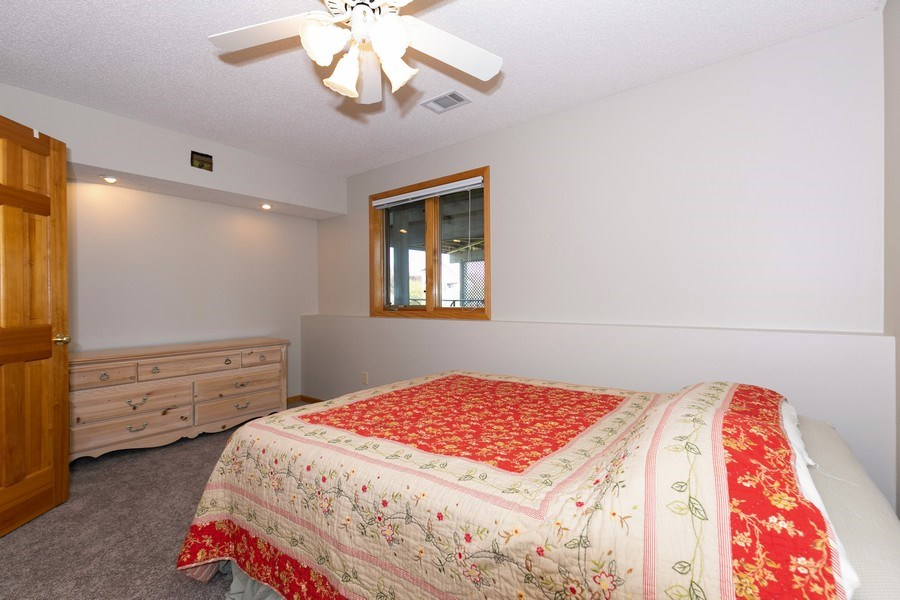 Real Estate Photography - 4100 Edinbrook Ter, Brooklyn Park, MN, 55443 - 2nd Bedroom