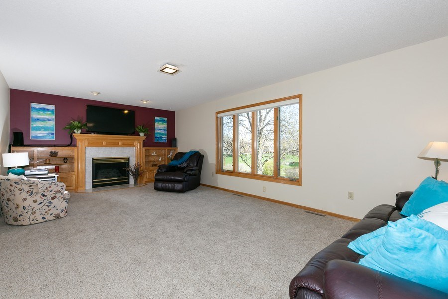 Real Estate Photography - 4100 Edinbrook Ter, Brooklyn Park, MN, 55443 - Living Room