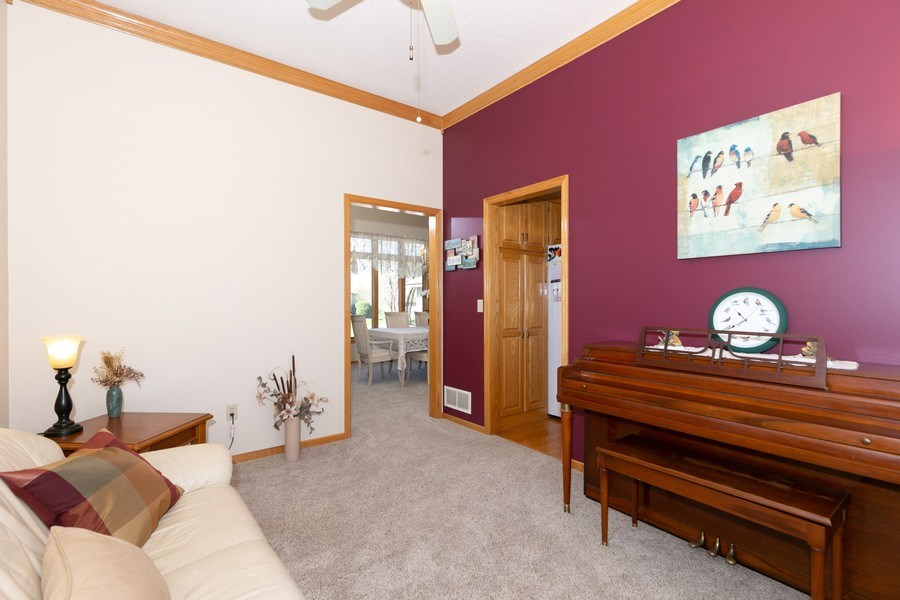 Real Estate Photography - 4100 Edinbrook Ter, Brooklyn Park, MN, 55443 - Sitting Room
