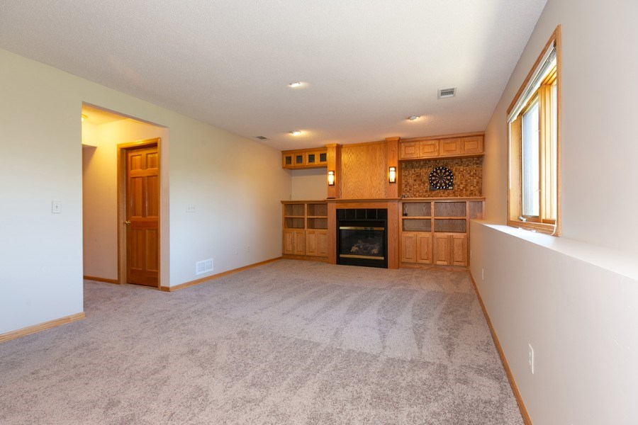 Real Estate Photography - 4100 Edinbrook Ter, Brooklyn Park, MN, 55443 - Family Room