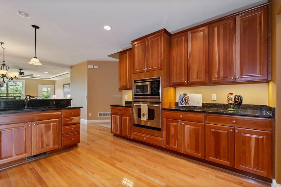 Real Estate Photography - 4850 Steeplechase Cir, Eagan, MN, 55122 - Kitchen/Dining