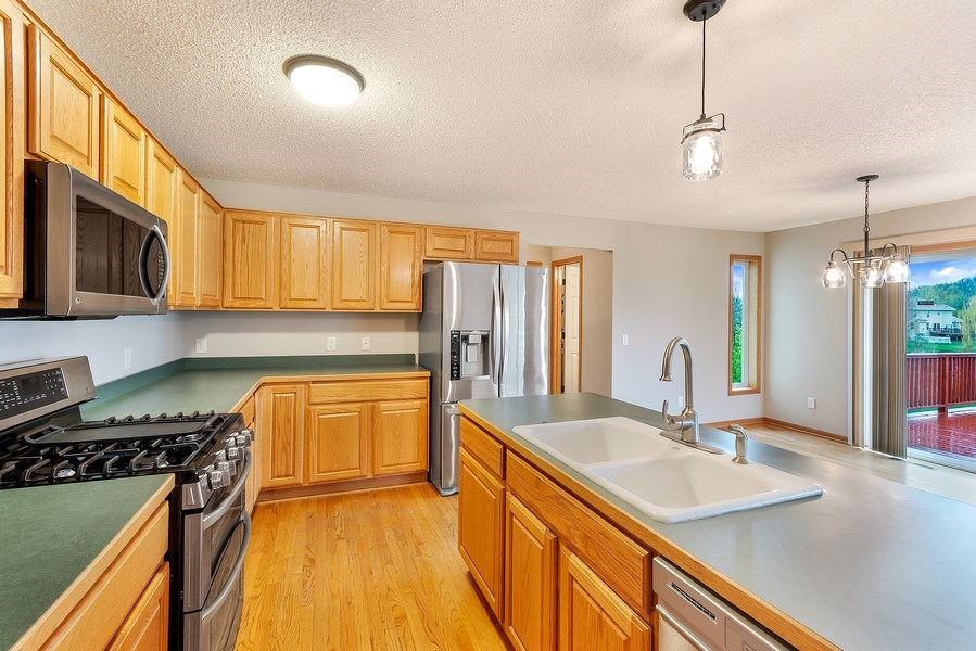 Real Estate Photography - 10686 182nd Ave NW, Elk River, MN, 55330 - Kitchen